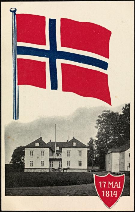 Postkort med bilde av det norske flagget og Eidsvollsbygningen fra 1914. Foto: ukjent. Eier: Nasjonalbiblioteket, tilgjengelig under CC BY 2.0