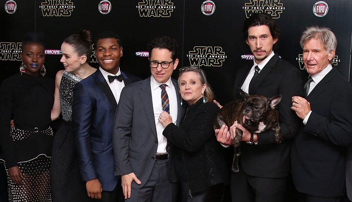 Lupita Nyong'o, from left, Daisy Ridley, John Boyega, J.J. Abrams, Carrie Fischer, Adam Driver and Harrison Ford pose for photographers upon arrival at the European premiere of the film 'Star Wars: The Force Awakens ' in London, Wednesday, Dec. 16, 2015. (Photo by Joel Ryan/Invision/AP)